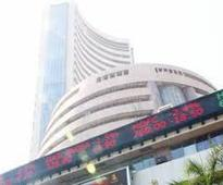 Sensex dives 261 points on muted earnings, tax worries