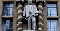 Oxford college accused of bowing to donors to keep Rhodes statue