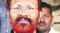 DG Vanzara stokes controversy, puts garland with toy gun on Sardar Patel's statue in Surat