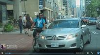 Rider Now Charged In Cab Versus Cyclist Incident On Bay Street
