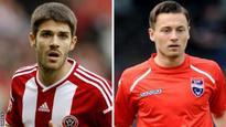 Oldham sign midfielders Flynn and Klok