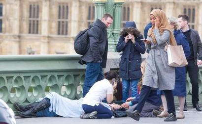 London terror: Pic of woman in headscarf 'casually' walking by dead man goes viral