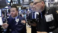 Dow falls triple digits as Street eyes strong yen, euro; Apple tries for gains