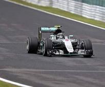 Japanese Grand Prix: Rosberg secures pole, tightens noose on Hamilton