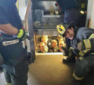 US firefighter snapped giving the thumbs up while rescuing cops trapped in elevator