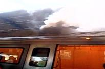 Smoke emits from a stationary metro train at Patel Nagar metro station