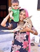 Women of this Indian community breastfeed deer alongside their own baby