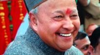Himachal Pradesh Chief Minister Virbhadra Singh distributes free laptops to students