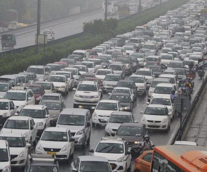PHOTOS: Drenched Gurugram asks Delhi to stay away