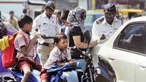 Not 1, but 2, government tells two-wheeler dealers as it makes helmets must for pillion riders