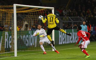 Aubameyang hat-trick leads Dortmund into last eight