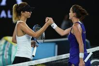 Third seed Radwanska battles into Open second round