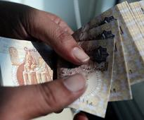 No quick portfolio inflows due to Egypt devaluation, fund managers say