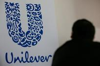 UPDATE 2-Price rises help Unilever top sales forecasts but spark Tesco row