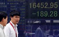 Global shares mixed as Fed rate hike seen as less likely