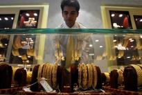 Gold falls to 8-week low as safe-haven demand sags