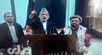 Karzai faces slogans chanted against him