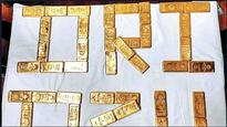 DRI Ahmedabad seizes Rs 50L gold concealed in rectum and trousers of two fliers