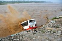 Heavy rain in China kills at least 87, forces thousands to evacuate