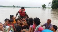 Flash floods kill scores in Nepal, Assam