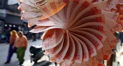 Rupee gains 14 paise against dollar