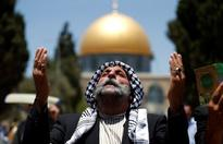 Palestinian Muslim pray in front of the Dome of the Rock in Jerusalem's al-Aqsa mosque compound