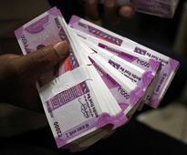 Indian rupee seen weathering dollar surge better than most in emerging FX