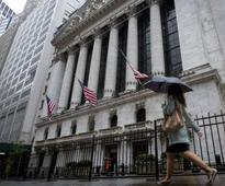 Wall St pares gains; media reports New York doctor may have Ebola