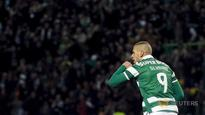 Football: Slimani scores twice as Sporting keep title race alive