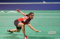 Saina beats Juan Gu to reach second round at Singapore