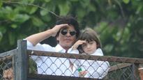 See Pictures: Shah Rukh Khan and AbRam wish fans on Eid at Mannat
