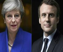 Football: France honours terror victims as Macron, May attend England friendly