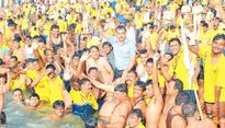 Director general takes holy dip with Home Guards volunteers