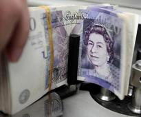 Sterling hits 31-year low, gilt yield below 1 percent for first time ever