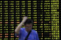 China shares dip on economy, yuan jitters; Brexit fears hit Hong Kong