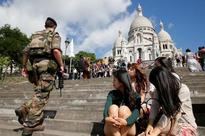France plans security measures to reassure Asian tourists - paper