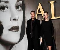 Brad Pitt and Marion Cotillard hit the red carpet for WWII thriller 'Allied'