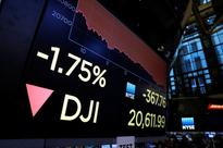 Asian shares fall as White House turmoil spoils risk sentiment, dollar bruised