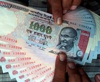 Rupee gives up early gains to trade at 61.12/dollar