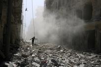 Syrian warplanes pound Aleppo's camp, residential areas