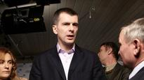 Kremlin says no political agenda behind search of billionaire Mikhail Prokhorov's offices