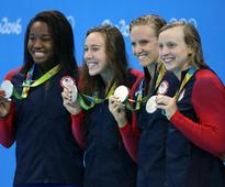 Katie Ledecky and Simone Manuel Get Very Warm Airport Welcomes