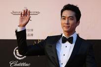 Actor Song Seung Heon arrives for the red carpet of the 17th Shanghai International Film Festival at Shanghai Grand Theatre on June 14, 2014 in Shanghai, China.