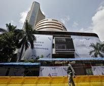 Sensex hits new high, Nifty retreats from record level on F&O expiry day