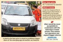 Uber cuts base price
