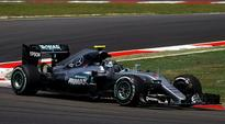 Nico Rosberg tops Malaysian Grand Prix practice, Kevin Magnussen catches fire