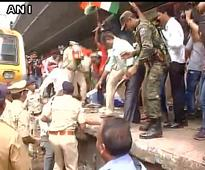 Mumbai: Local train services on Central line affected as Congress workers demonstrate over farmers protest