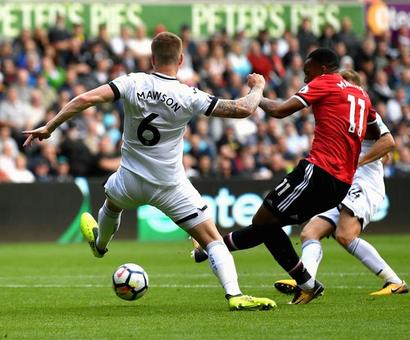 EPL PHOTOS: United rout Swansea, Liverpool edge past Palace