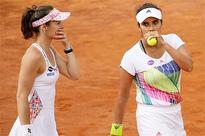 Sania, Martina labour into second round of French Open