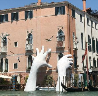 Why giant hands are emerging from the water in Venice